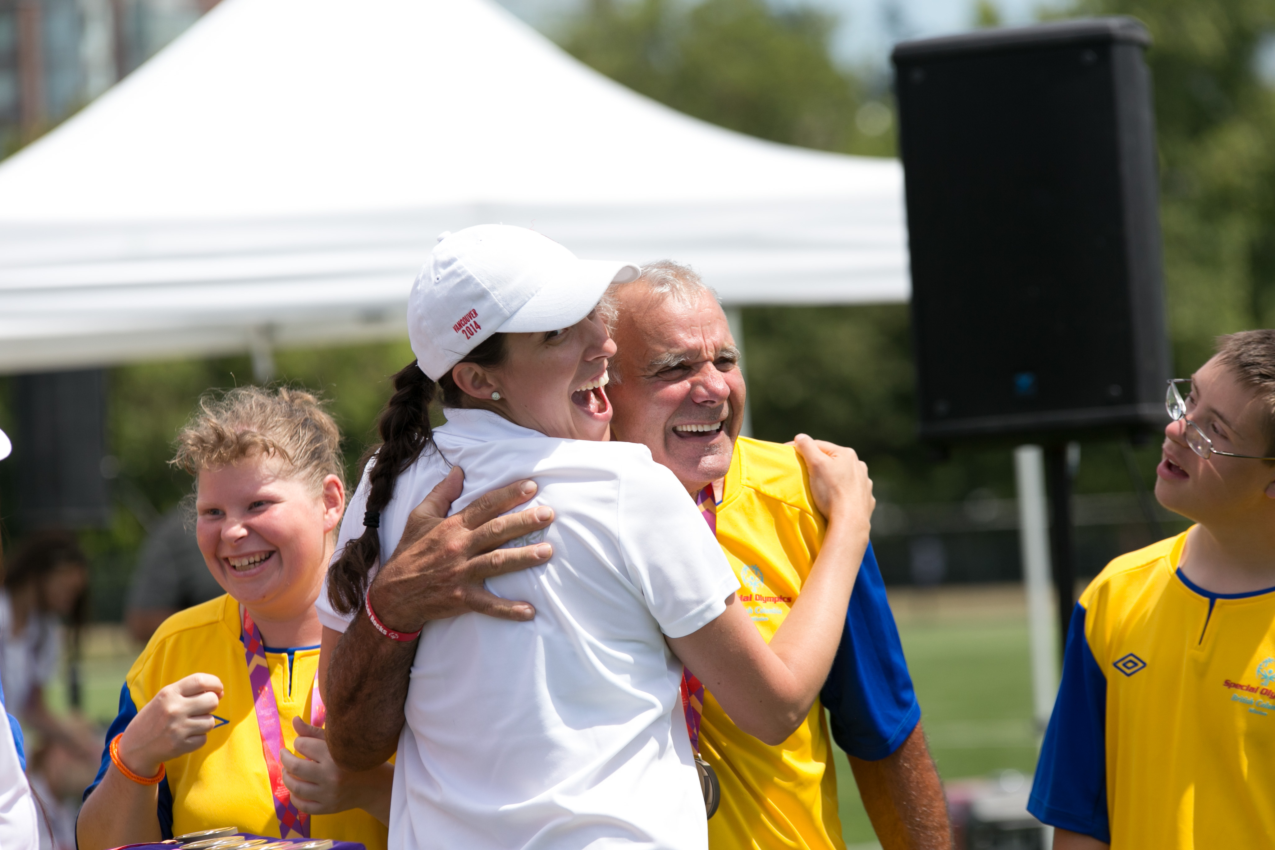 volunteer and athlete hugging