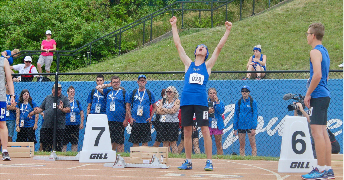 An athlete cheers at a competition