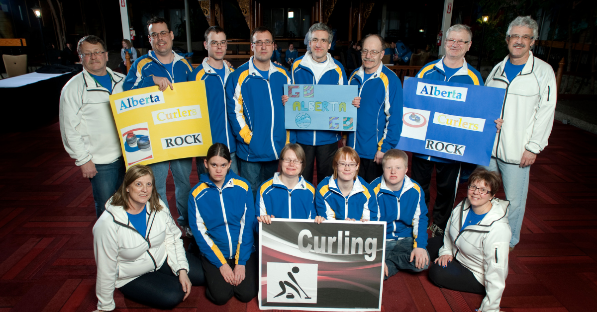 Heather Roberts poses for a photo with Team Alberta curlers in 2006.
