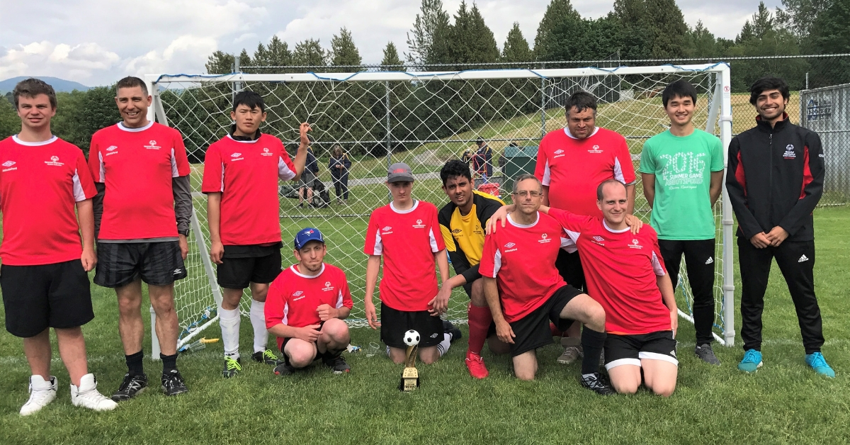 Roshan Gosal with his Special Olympics B.C. soccer team.