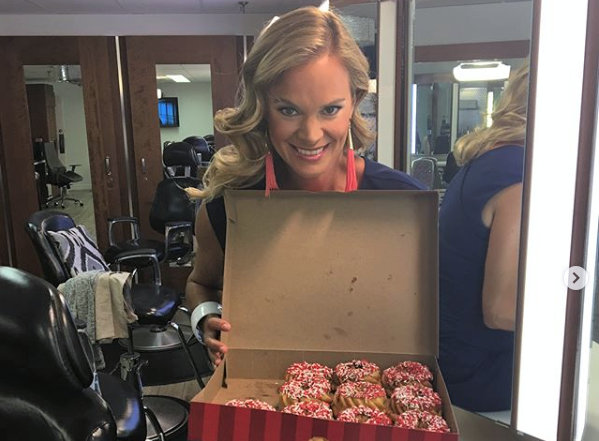 Jennifer Hedger post a picture with a box of Special Olympics Donuts.