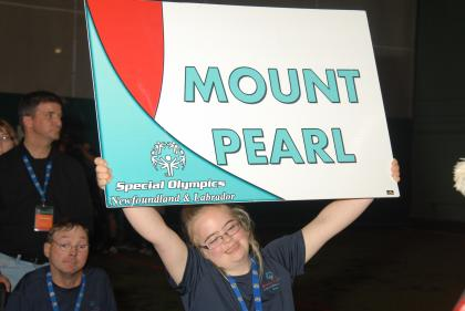 Athlete with Mount Pearl Sign