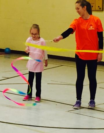 Young Athlete and Coach practicing their Rhythmic Gymnastics