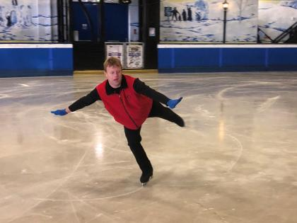 Tim Goodacre performs on the ice.