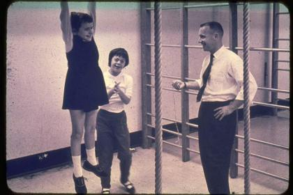 Black and white photo of Dr. Frank conducting fitness tests at the Beverley School in 1960s