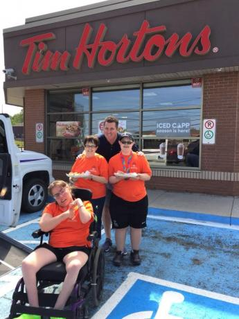 A picture of Heather Miller and other Special Olympics athletes at a Tim Hortons on Day of Inclusion last year.