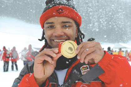 Special Olympics athlete holds up World Games medal while it's snowing.