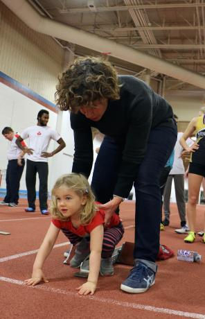 Marnie and daughter Isabel try out some races at Athletics Training Camp.