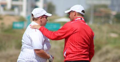 Glenn Cundari chats with SO Team Canada golfer Krista Stockman on the course in Abu Dhabi.