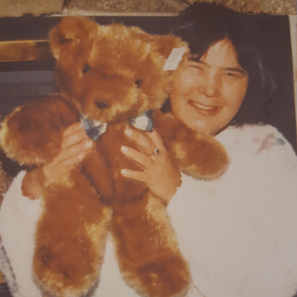 Al Dyer's sister Eloise holds a teddy bear in an old photo.