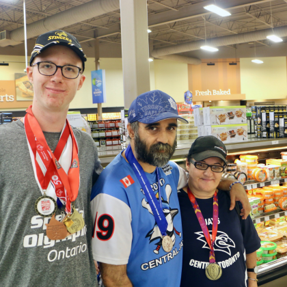 Special Olympics athletes pose for a photo at Sobeys