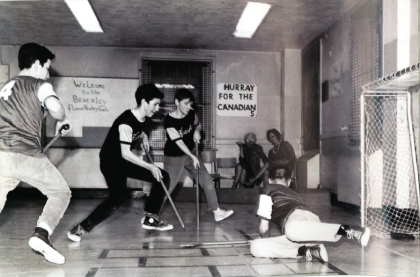 Floor hockey players compete in the basement of the Beverley School