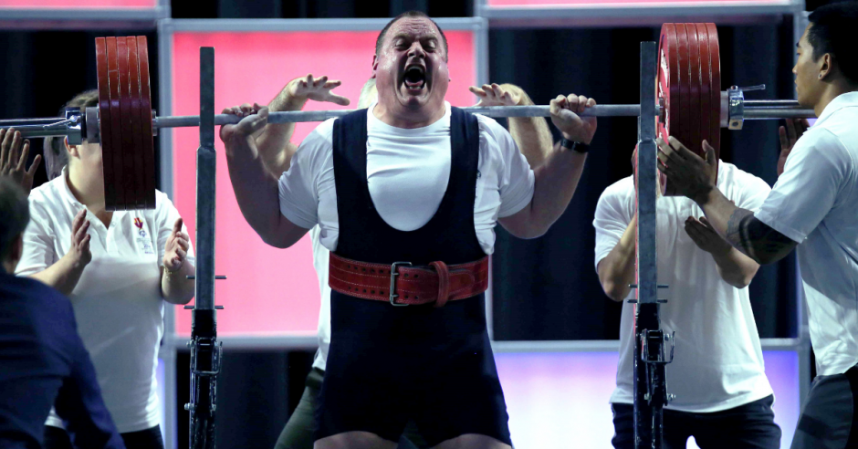 Jackie Barrett screams out as he competes in the squat competition at the World Games in LA
