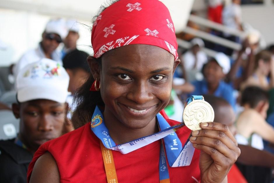 """Monique Shah holds up her medal at the Special Olympics World Games in Athens 2011."
