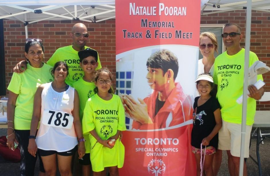 The Pooran family stand for a photo at the Natalie Pooran Memorial Track Meet in 2018