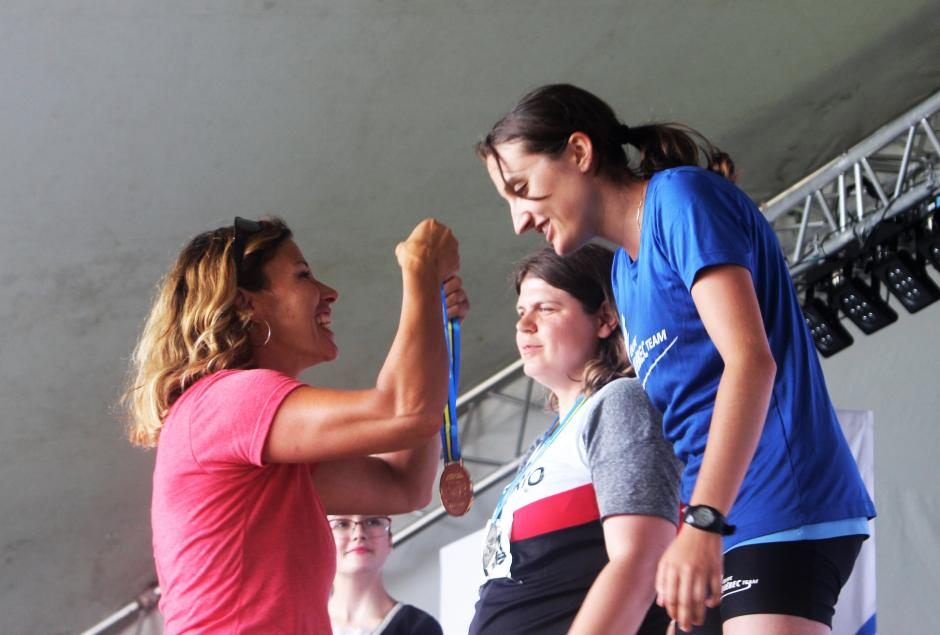 Olympic athlete Catriona Le May Doan places a medal on a Special Olympics athlete.