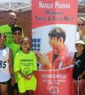 The Pooran family stand for a p hoto at the Natalie Pooran Memorial Track Meet