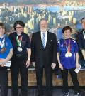 Special Olympics BC – Vancouver athletes with New Car Dealers Association of BC Chairman Jeff Hall