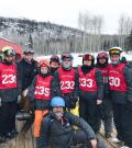 Martin McSween poses for a photo with his ski team.