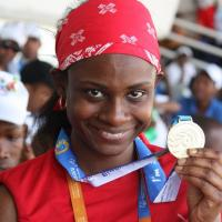Monique Shah holds up her medal at the Special Olympics World Games in Athens 2011