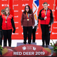Melanie stands on the first place podium at Canada Games