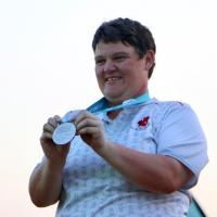 """Erin Thom is all smiles as she receives her silver medal after four days on the golf course."""