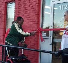 George Cutting the ribbon