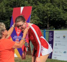 Annick Leger receives a medal at the Special Olympics Canada National Games, Vancouver 2014