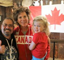Marnie McBean with daughter Isabel and Special Olympics Team Canada athlete.