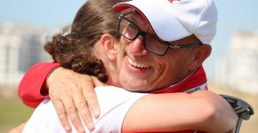 Glenn Cundari hugs one of his SO Team Canada golfers.