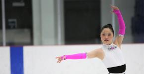 Special Olympics Alberta athlete Meg Ohsada poses on the ice