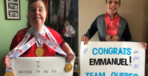 Two Special Olympics athletes hold up signs