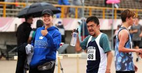 Kyla on the track with a Special Olympics athlete.