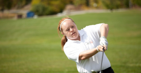 Special Olympics athlete Tess Trojan swings a golf club