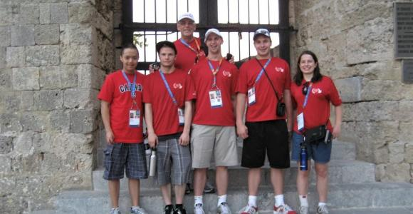 Gord Stewart poses with athletes while seeing the sights at the World Games in Greece.