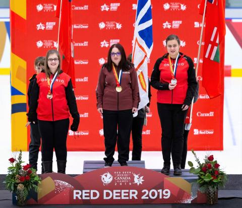 Melanie Taylor stands on the first place podium at Canada Games