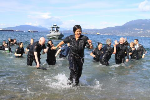 Lots of high-fives as the Vancouver Police Department team takes the Plunge. Photo by Tim Fitzgerald.
