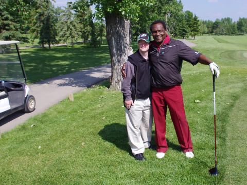 George Reed with a local athlete at the George Reed Golf Tournament for Special Olympics in Regina.
