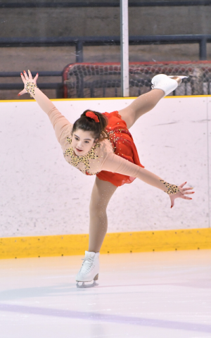 Grace Morris skates on the ice