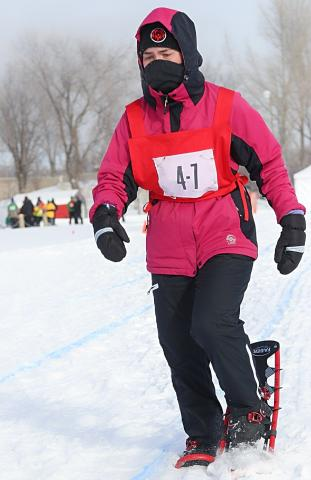 Madalyn snowshoes at the Provincial Winter Games