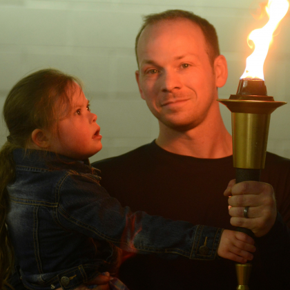 Mike and Kelsey hold the Flame of Hope at the 2018 Bowling Championships.